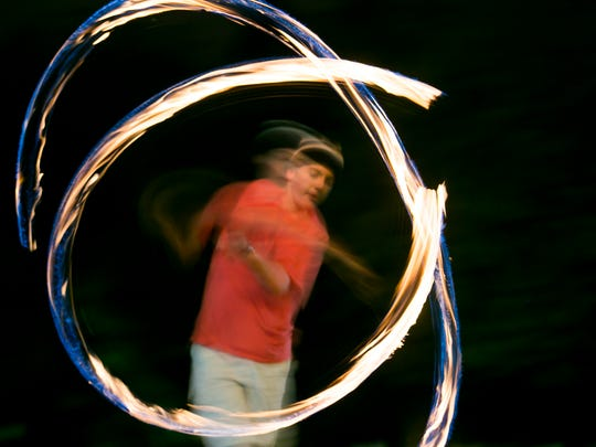 Willamette University freshman Andy Hunter spins ball-and-chain poi at a club meeting on April 14. Hunter, from Santa Barbara, California, has been spinning poi since he started at Willamette in September.