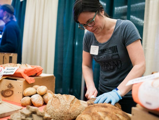 Sophie Conway of O Bread bakery slices bread samples