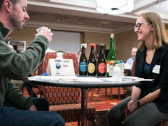Kim Beaty, right, of Shacksbury Cider, talks to a retailer
