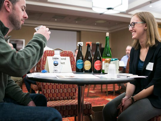 Kim Beaty, right, of Shacksbury Cider, talks to a retailer during a matchup session the Vermont Retail & Grocers Association Convention & Expo at the Hilton in Burlington on Friday, April 29 2016.
