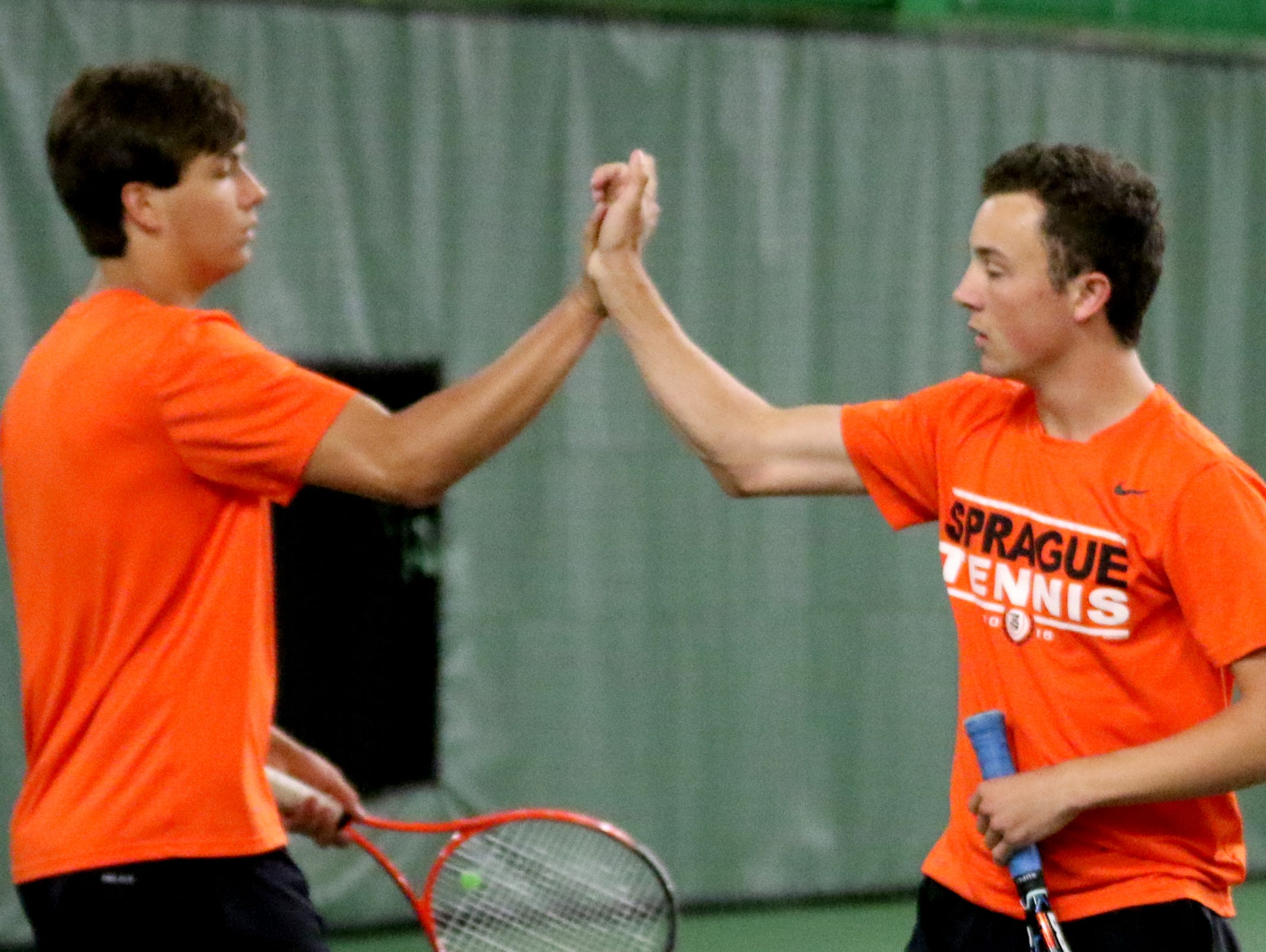 Sprague's Nate Harder, left, and Jonah Lovell high-five while competing as a doubles pair in the Sprague vs. McKay boy's tennis meet at the Courthouse Tennis Center in Salem on Thursday, May 5, 2016.