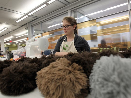 Colleen Theisen, Special Collections outreach and engagement librarian, helps sew together Star Trek tribbles on Wednesday, May 4, 2016. The tribbles are on display with other Star Trek memorabilia at the University of Iowa Main Library and may be sold to help start a scholarship in the future.