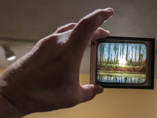 Hand-painted glass slides are part of a photography