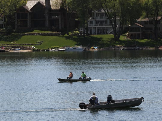 Fishermen enjoy an afternoon on Lake MacBride near the beach on Friday, May 6, 2016. The Iowa Department of Natural Resources has drafted a rule with a stricter ban on alcohol at the beach after an increased number of incidents.