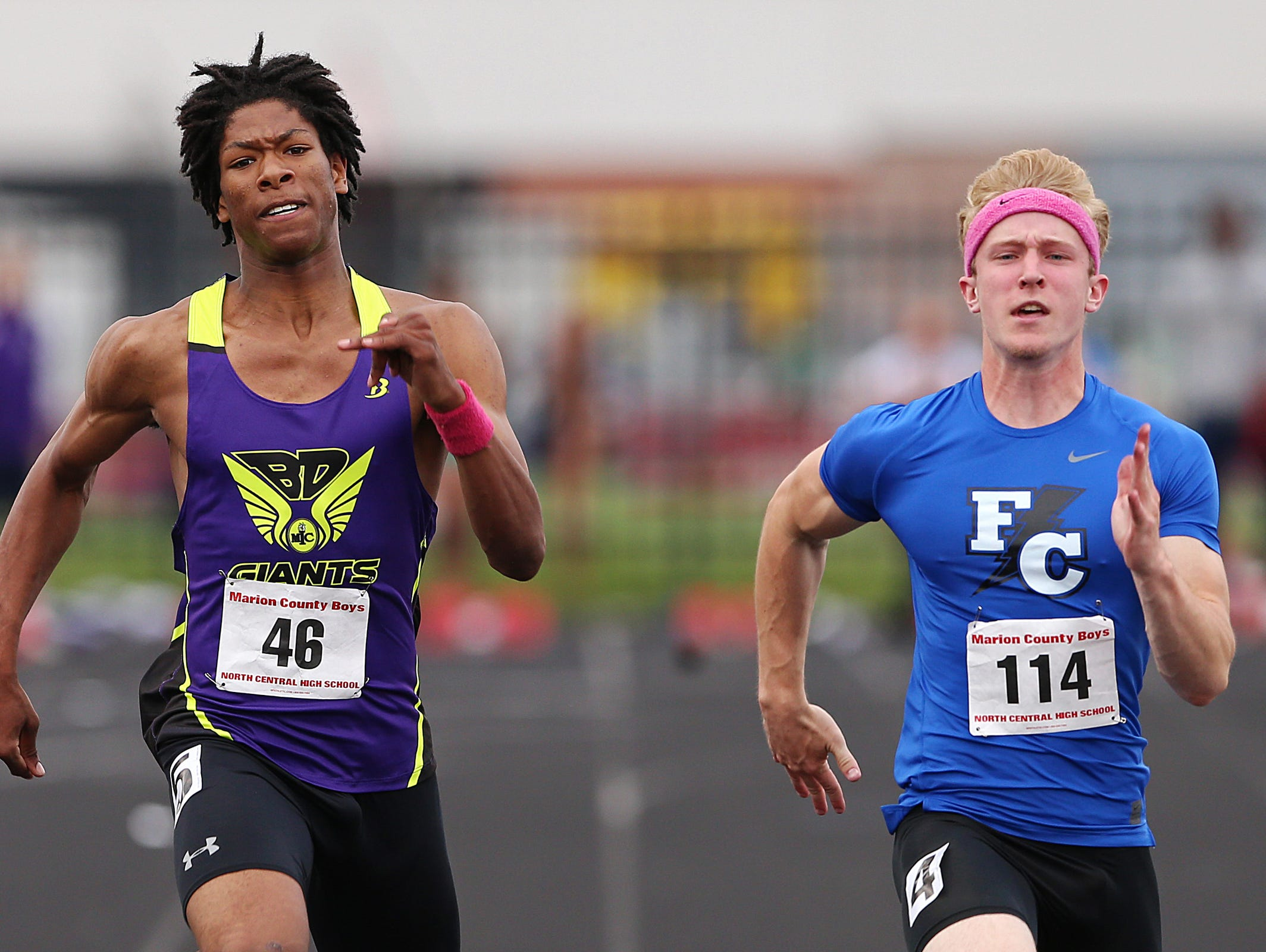 From left, Ben Davis senior Christian Powell and Franklin Central senior Andrew DeRidder approach a tight finish in the 100 meter dash, during a Marion County boys track meet at North Central High School, Indianapolis, Wednesday, May 11, 2016. Powell placed second, and DeRidder placed first, in 10.83 seconds.