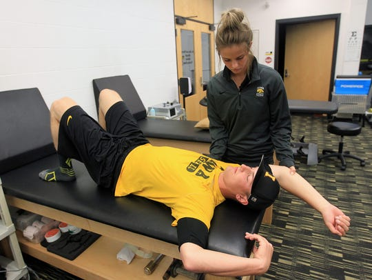Iowa's Calvin Mathews works with Erika Harrison, the