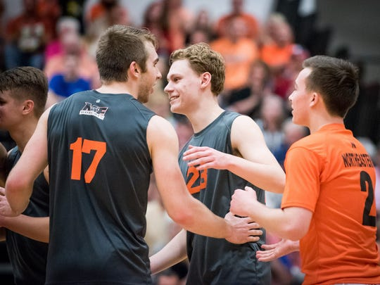 Northeastern's Reese Devilbiss (17) and Brandon Arentz (23) react after a point against Central York on  Thursday night.