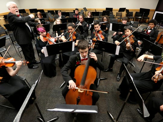 The North Salem High School full symphony, directed by Larry Garrett, warms up before performing in the OSAA Orchestra State Championships at the LaSells Stewart Center at Oregon State University in Corvallis on Thursday, May 12, 2016.