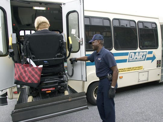 A DART paratransit operator helps a disabled rider onto a bus. DART will close Maryland Avenue in Wilmington on Saturday and Sunday to build a new paratransit base at its facility there.