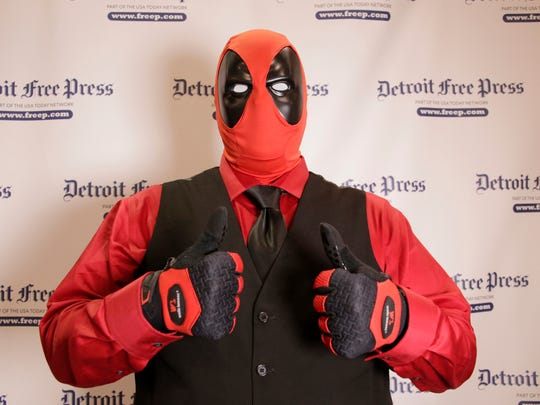 Motor City Comic Con 2016 attendee Garry Wynn of Milan, dressed as Deadpool poses at the Suburban Collection Showplace in Novi Friday May 13, 2016.