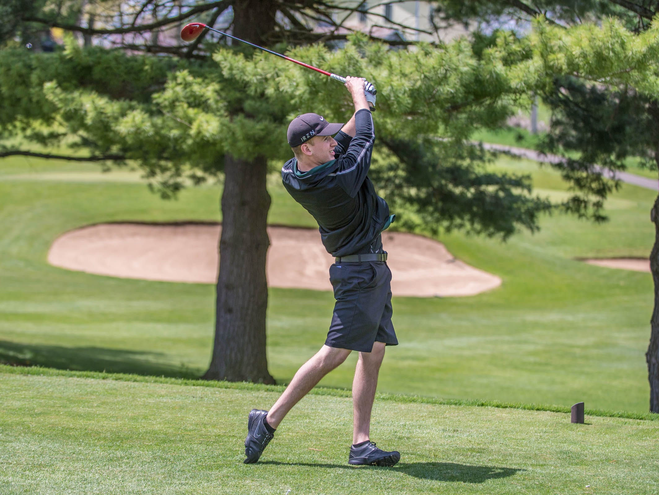 Pennfield senior Chase Williamson hits his drive during All City High School Golf at Riverside Golf Club on Friday.