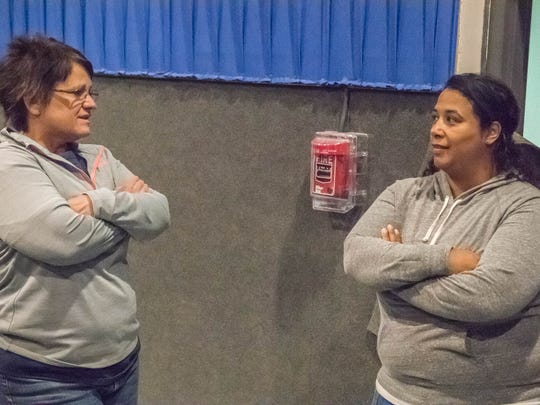 Kim LoPresti (left), Moore Theaters' regional supervisor, and Daria Moore (right), the company's executive assistant to owner Carol Moore, discuss the new JC Cinema theater at 15375 S. Helmer Road. It is expected to open up sometime in June.