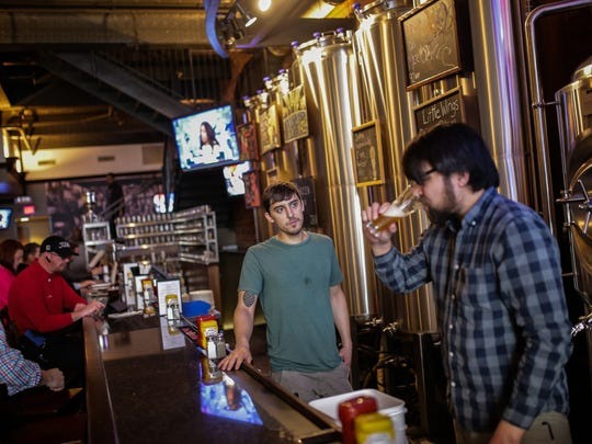 Detroit Beer Co. assistant brewer Richard Chesstnutt (right) samples a beer by brewmaster Justin Riopelle as they prepare to make their 'Baseball Beer' on Thursday March 31, 2016 at the business in downtown Detroit as the they ready for the Detroit Tigers Opening Day.