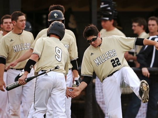 Noblesville Millers' Nolan Vallier (22) congratulates Neil Brown (9) after scoring a run, at Field of Dreams diamond, Noblesville, Ind., Tuesday, April 19, 2016.
