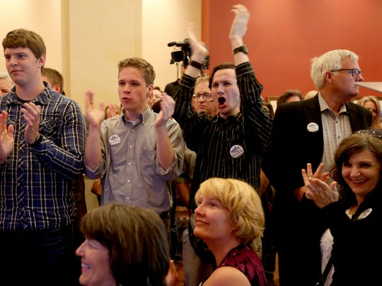 Supporters of Republican gubernatorial candidate Bud Pierce react to campaign results being shown during his campaign's election night party at the Grand Hotel in downtown Salem on Tuesday, May 17, 2016.