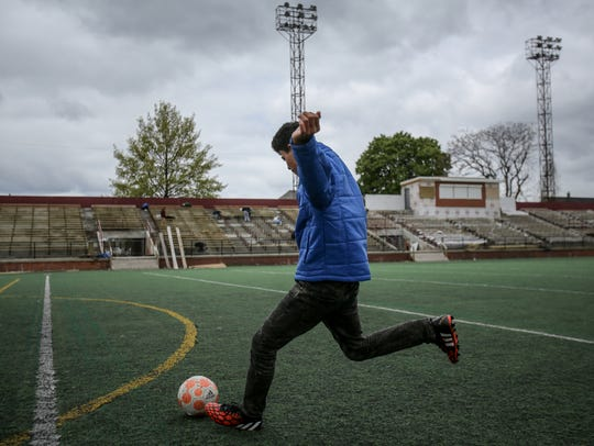 Zayd Almadrahi, 14, of Hamtrack practices soccer at