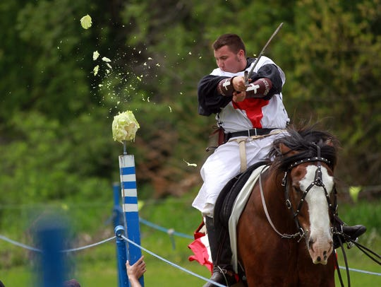 Dane Gambrall takes part in a jousting competition