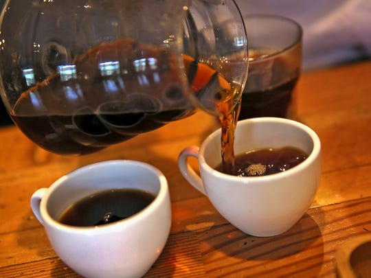 Coffee is poured at Bee Coffee Roasters, Thursday, May 19, 2016.  The coffeehouse is at 201 S. Capital Ave., downtown.
