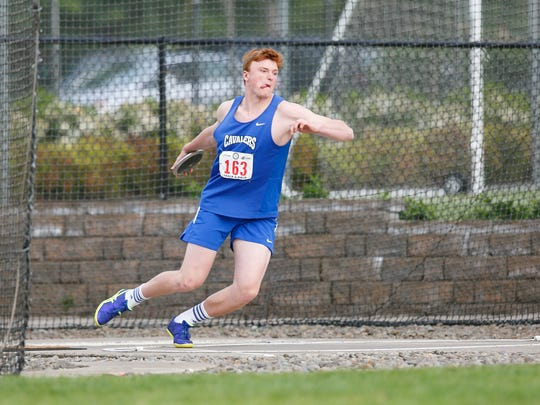 Blanchet's Ben Bartch throws discus at the OSAA Track and Field State Championships at Hayward Field in Eugene on Friday, May 20, 2016.