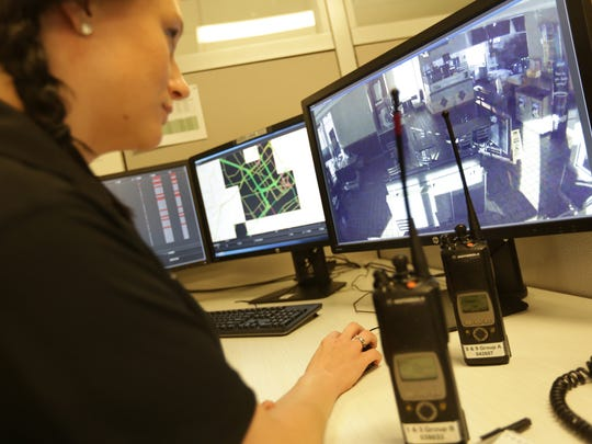 """Breanna Lingo and other crime analysts at Detroit's public safety headquarters monitor Project Green Light businesses constantly. The project is """"making criminals think twice,"""" Detroit Mayor Mike Duggan said. McDonald's is the latest to join."""