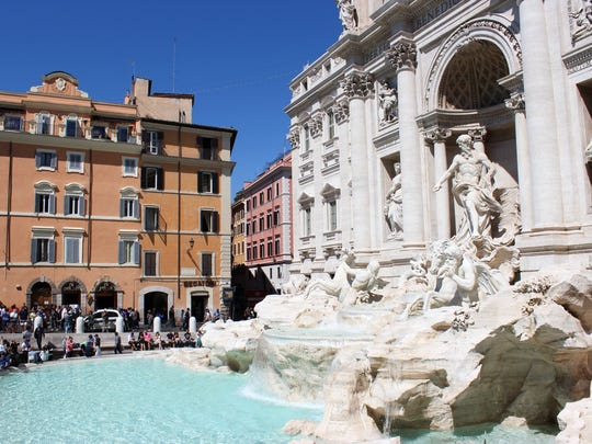 The newly restored Trevi Fountain in Rome, Italy, draws  thousands of tourists.