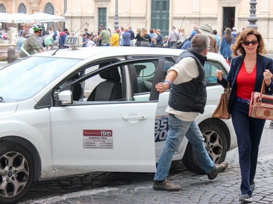 "Rome taxis may be confusing for visitors, but look for white cars with ""taxi"" on the top and prices on the side door."