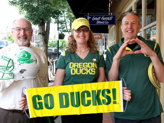 Gordon Hanna, from left, Anita Stromme and Kevin Hohnbaum, Oregon boosters, came down to promote a benefit that will fund athletic scholarships at the University of Oregon.