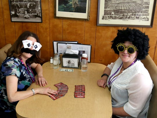 Debra Maryamov, left, and Tiffany Hamilton came out incognito to promote a Monte Carlo Casino Night to benefit the creation of a Marion County CourtCare center in Salem.