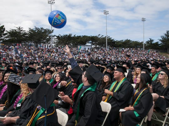 A balloon hovers over graduates at the CSUMB commencement on Saturday.