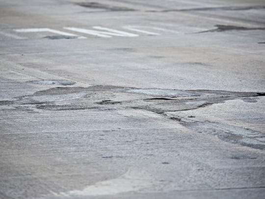 A detailed view of the road condition near the corner of Schoenherr Road and Hall Road on May 26, 2016, in Sterling Heights.