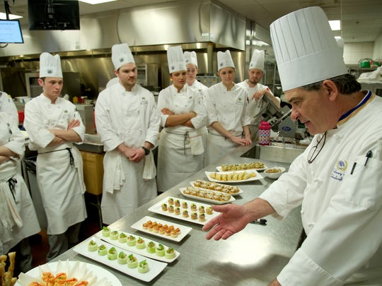 Chef Brian Polcyn teaches a charcuterie class at Schoolcraft College in 2015.