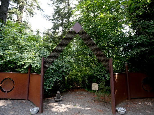 Kathy and John Palmer's garden at their Salem home includes an affirmation trail that criss-crosses a quarter mile through a forested area.