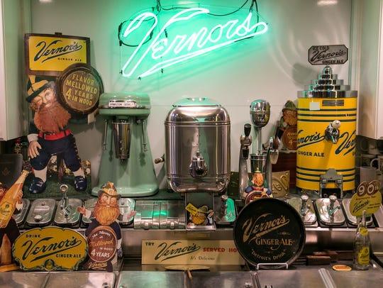 Multiple Vernors Ginger Ale memorabilia line a soda