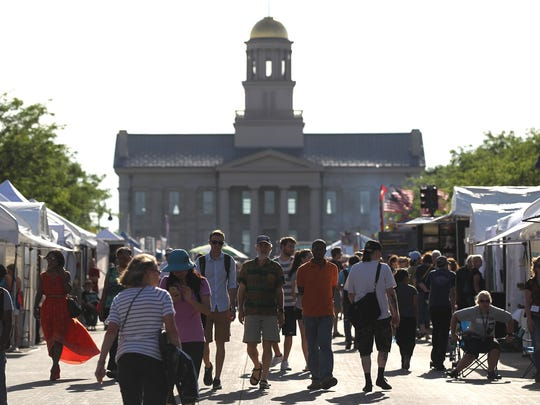 Iowa Arts Festival attendees browse food tents on Iowa Avenue on Friday, June 3, 2016.