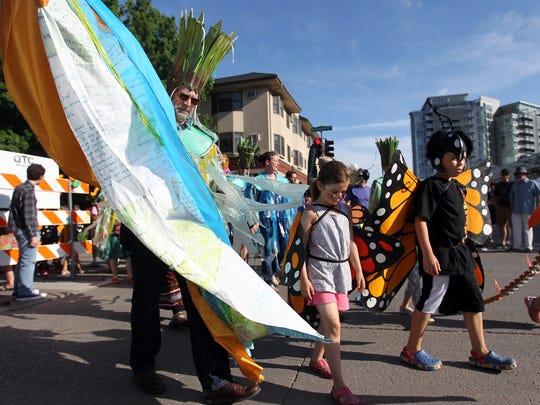 Parade participants march down Washington Street at