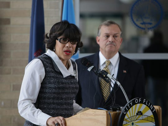 Flint Mayor Karen Weaver speaks to the press while accompanied by retired National Guard Brigadier General Michael C.H. McDaniel on Tuesda, Feb. 9, 2016, at Flint City Hall.
