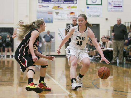 West Salem junior Delaney Henery (11) drives towards the basket in a game against North Medford at West Salem High School on Tuesday, March 1, 2016. West Salem won the OSAA round one playoff game 58-55 in overtime.