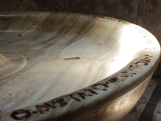 "In the Forum baths at Pompeii, Italy. The writing on the edge of the tub was an early version of ""naming rights"""