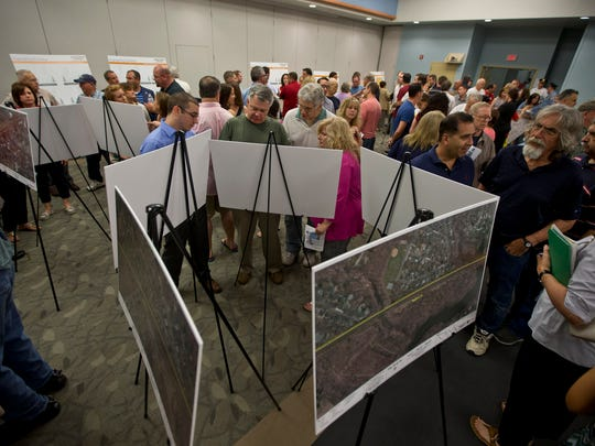 JCP&L holds the first of three open houses about its proposed project to construct a 10-mile transmission line along the NJ Transit tracks between Red Bank and Aberdeen.