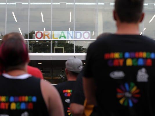 636014505125270833-IOW-0613-Orlando-vigil-13.jpg