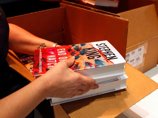 """Stephen King's newest release, the third volume in his Bill Hodges Trilogy, entitled """"End of Watch"""" is passed out following his appearance during an event hosted by Carmicheal's Bookstore.  The books were distruted at random and 400 lucky fans received a signed copy.  June 12, 2016"""