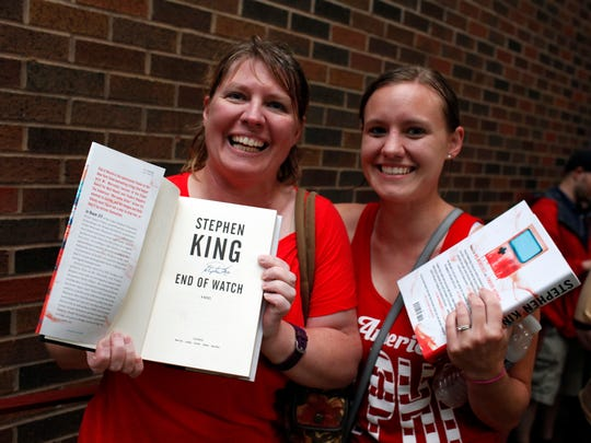 """Jennifer Smith, left, with her daughter Megan Summers reacts to receiving a signed copy of Stephen King's newest release, the third volume in his Bill Hodges Trilogy, entitled """"End of Watch"""" during an event hosted by Carmicheal's Bookstore. The books were distruted at random and 400 lucky fans received a signed copy.  June 12, 2016"""