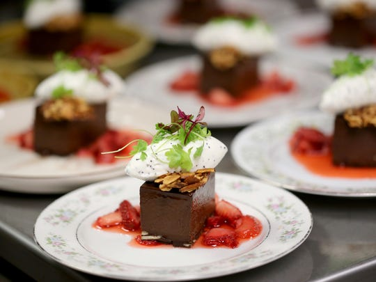 Dark chocolate dessert bar, macerated strawberry, poppy seed creme fraiche, almond, micro herbs at James Rigato's Mabel Gray restaurant in Hazel Park during the Top 10 take over on Monday, June 13, 2016.  