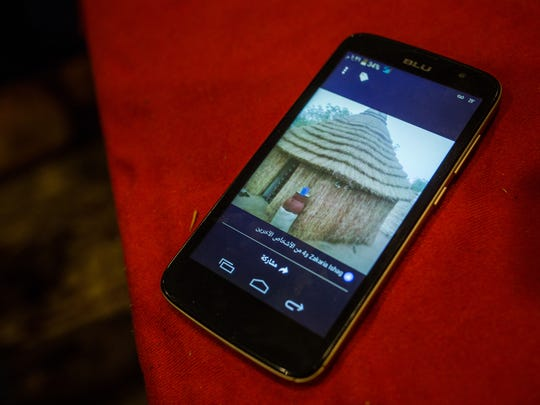 A photo of a mud hut similar to the one the Yacoub family  had in their village of Tukultukul, West of Darfur, in Sudan, is seen on the family's only cellphone on Wednesday, May 25, 2016, in Detroit.