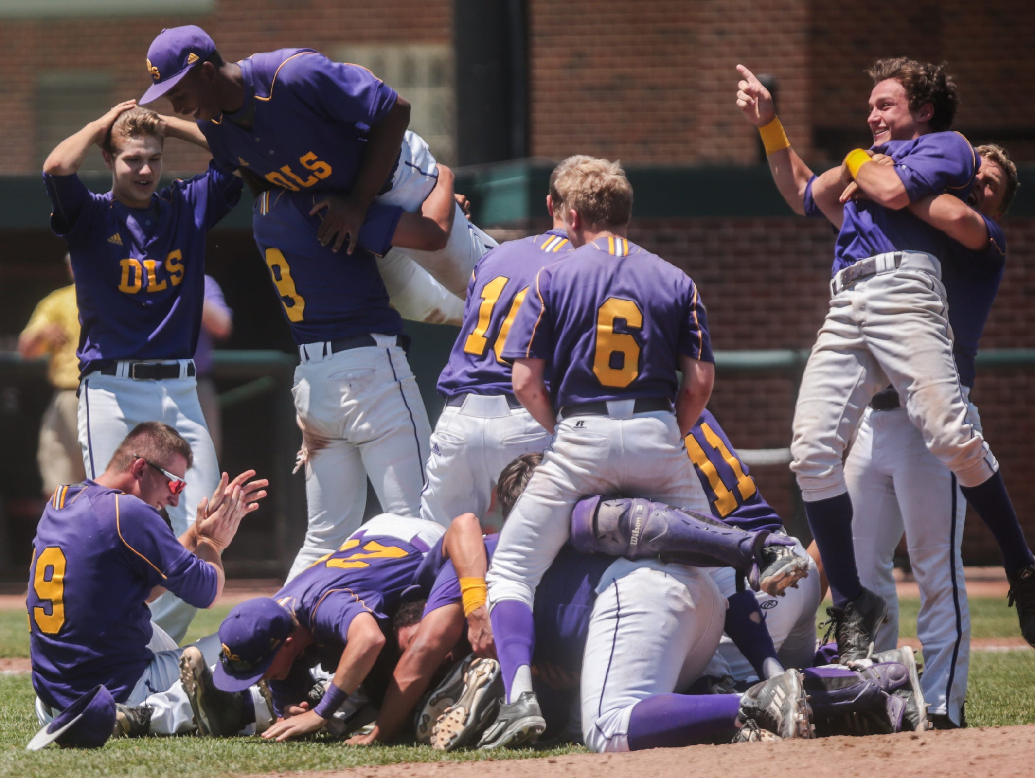 Warren DeLaSalle players celebrate winning the Championship 7-6 against Saline on Saturday, June 18, 2016 at the MHSAA Division 1 baseball Championship game at Michigan State University in East Lansing, MI.