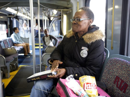 Doris Germany, 60, of the west side of Cleveland  takes the RTA's HealthLine to work Wednesday, June 8, 2016.