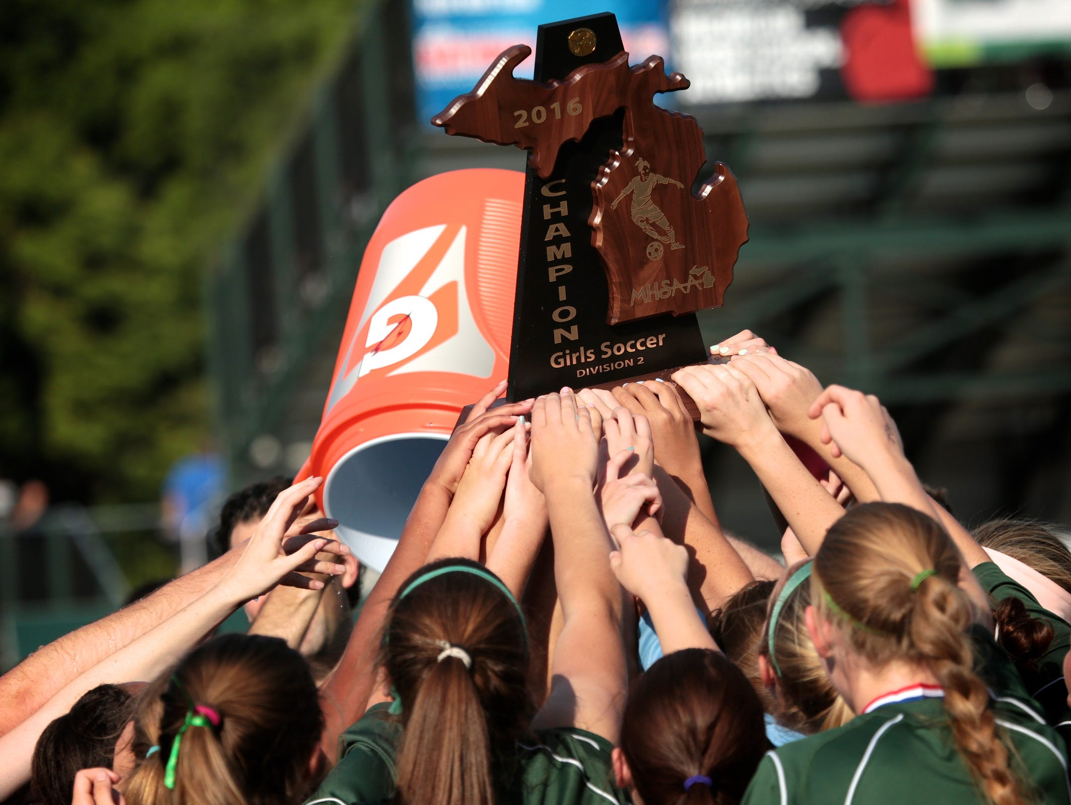 Notre Dame Prep players celebrate winning the Championship in the shootout against Forest Hills Northern on Saturday, June 18, 2016 at the MHSAA Division 2 soccer championship game at Michigan State University in East Lansing.