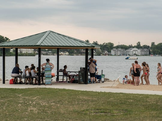 Kids and adults enjoy the water and sand at Willard