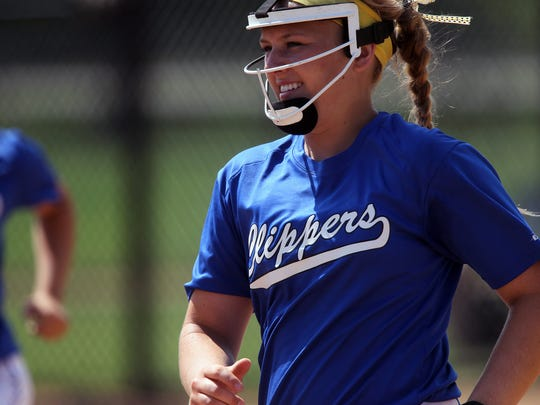 Clear Creek Amana pitcher Skylar Hop heads to the dugout between innings during the Clippers' game against Union at the Hawkeye Softball Complex on Friday, June 24, 2016.