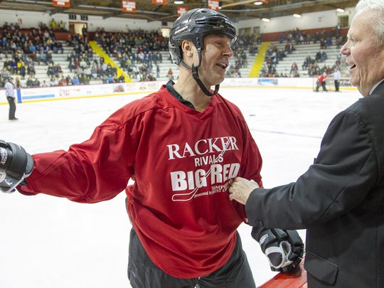 Hockey Hall of Famer Joe Nieuwendyk talks with National Lacrosse Hall of Famer Richie Moran during the Racker Rivals Big Red hockey benefit at Lynah Rink in 2014.